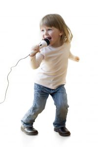 Little girl singing on a microphone